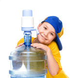 Cute girl with large water bottle — Stock Photo