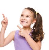 Roztomilá dívka drží její tvář v úžasu — Stock fotografie