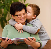 Grandmother is reading book with her grandson — Stock fotografie