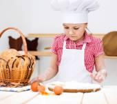 Girl making bread — Stock Photo