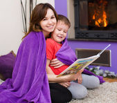 Mother is reading book with her son — Stock Photo