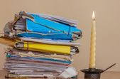 Documents to be read  in the light of a candle — Stock Photo