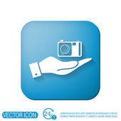 Hand holding a photo camera — Stock Vector