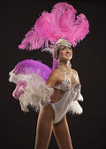 Burlesque dancer in white dress with pink plumage — Stock Photo
