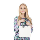 Young pretty woman standing with colourful shopping bags — Stock Photo