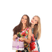 Shopping and tourism concept - beautiful girls with bags — Foto Stock