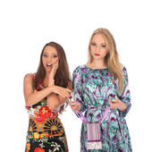 Shopping and tourism concept - beautiful girls with bags — Stock Photo