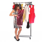 Which dress should I pick, young woman holding wear — Stock Photo