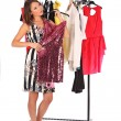 Which dress should I pick, young woman holding wear — Stock Photo #55950005