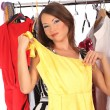 Which dress should I pick, young woman holding wear — Stock Photo #55950255
