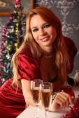 Woman celebrating christmas, smiling woman in evening dress with glass of sparkling champagne — Stock Photo
