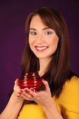 Portrait of beautiful sexy girl, holding candle, wearing santa claus clothes — Stock Photo