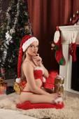 Beautiful woman near the fireplace in winter house. selebrating christmas — Stock Photo