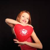 Young beautiful woman with big red heart — Stock Photo