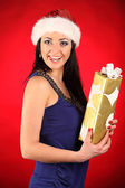 Beautiful and sexy woman wearing santa clause costume — Stock Photo