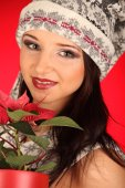Christmas girl with red flower in her hand — Stock Photo