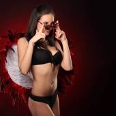 Valentines beauty girl with big red and white wings — Stock Photo