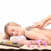 Young woman getting a massage in spa — Stock Photo