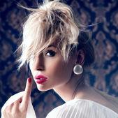 Delicate blonde woman posing — Stock Photo