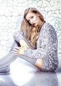Beautiful blonde woman wearing stockings — Stock Photo