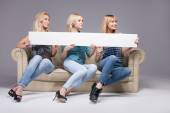 Three girls with empty board. — Stockfoto