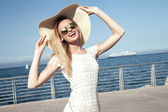 Smiling blonde lady on vacation. — Stock Photo