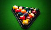 Pool balls on green snooker table — Stock Photo