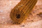 Rusty fencing material laying on floor — Stock Photo