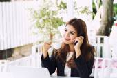 Asia young business woman sitting in a cafe with laptop iced cof — Stock Photo