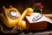 Retro phone and old book. — Stock Photo