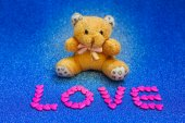 Teddy bear on blue background. — Stock Photo