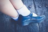 Schoolgirl wear a black leather shoes. — Stock Photo