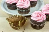 Chocolate Cupcakes with pink icing — Stock Photo