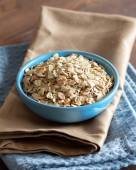 Uncooked rolled oats in a bowl — Foto de Stock