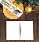 Festive table setting with notebook — Stock Photo