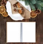 Festive table setting with spices and notebook — Stock Photo