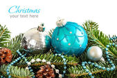 Turquoise and silver Christmas ornaments border — Stock Photo