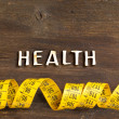 The word of Health on wood and measuring type — Stock Photo #60729501