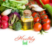 Vegetables and bottle of olive oil close up — Stock Photo