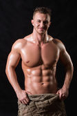 Bodybuilder in a bag — Stock Photo