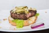 Spoiled tasteless burger with roasted not Cutlets, — Stock Photo