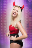 Female go go dancer.  girl wearing devil horns — Stock Photo