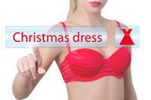 Woman pressing christmas dress button — Stock Photo