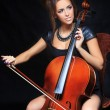Beautiful female musician playing a cello. — Stock Photo #60128725