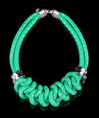Green Rope Necklace. on black background — Stock Photo
