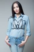 Girl in a denim shirt with straps — Stock Photo