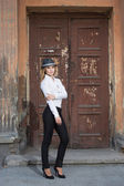 Beautiful blonde in a white blouse and a hat — Stock Photo