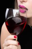 Woman with glass red wine. saturated color, nails. — Stock Photo