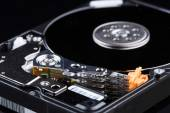Hard disk with moving head. — Stock Photo