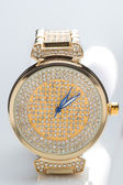 Gold watch with diamonds — Stock Photo
